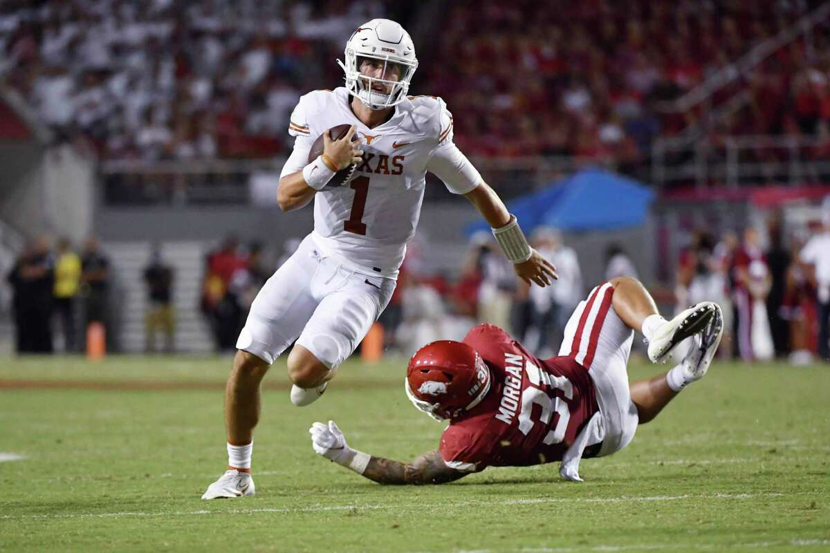 Hudson Card (1) will watch Casey Thompson start at quarterback for Texas against Rice on Saturday after struggling in the Longhorns' 40-21 road loss to Arkansas.