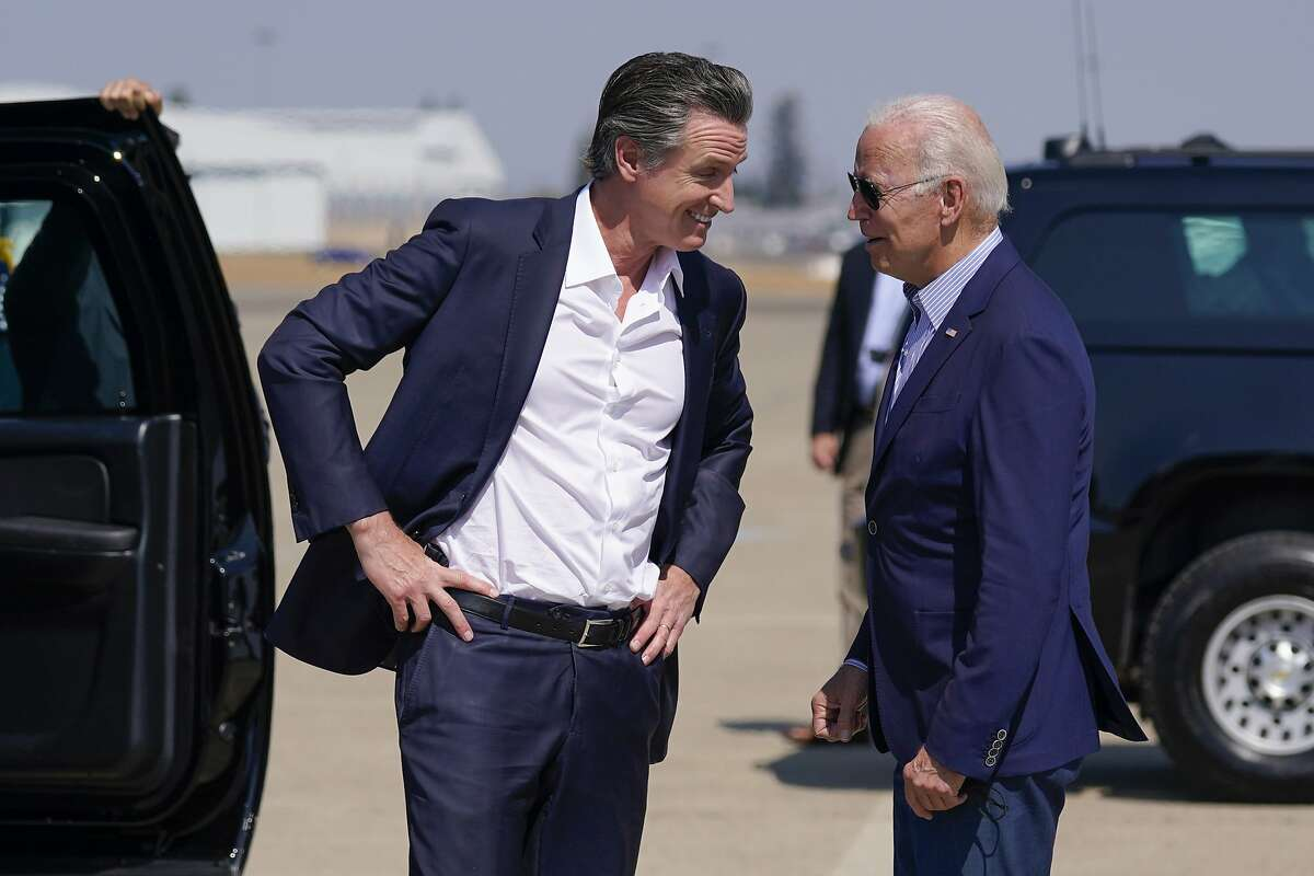 President Joe Biden talks with California Gov. Gavin Newsom as he arrives at Mather Airport on Air Force One Monday, Sept. 13, 2021, in Mather, Calif., for a briefing on wildfires at the California Governor's Office of Emergency Services. (AP Photo/Evan Vucci)