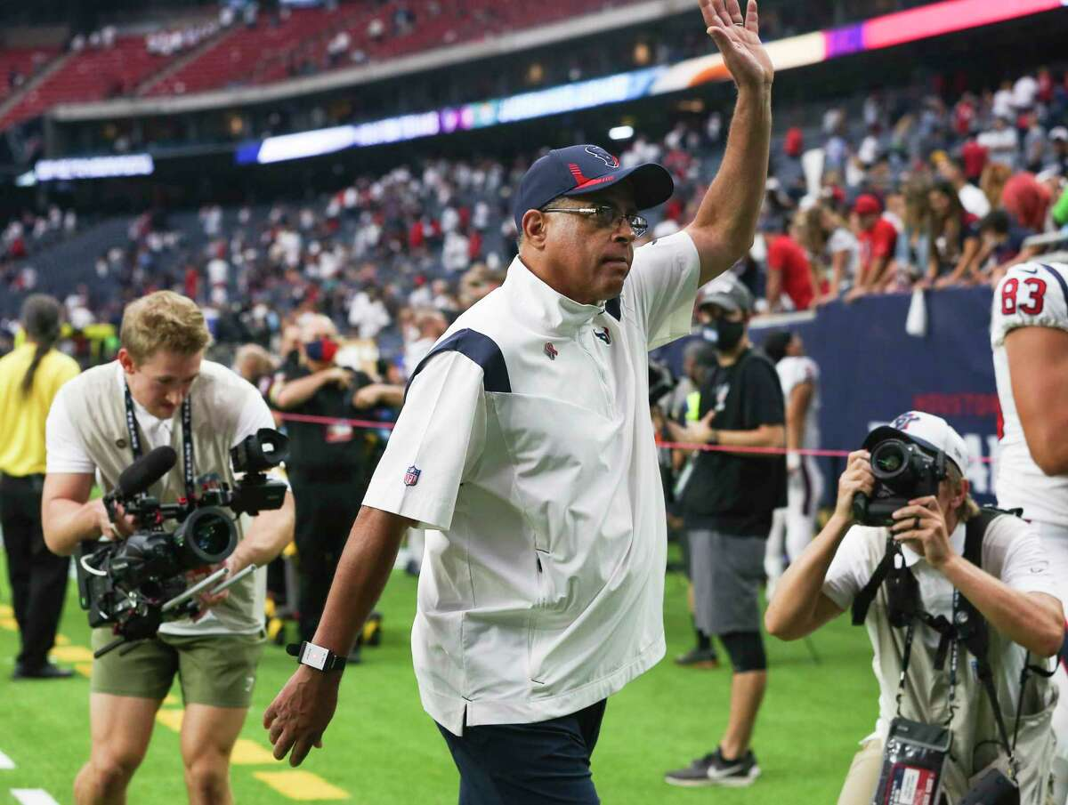 Texans coach David Culley, waving to crowd after opening victory, received the game ball from the players.