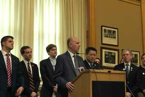 Rep. Gregg Haddad, D-Mansfield, center, in a file photo.