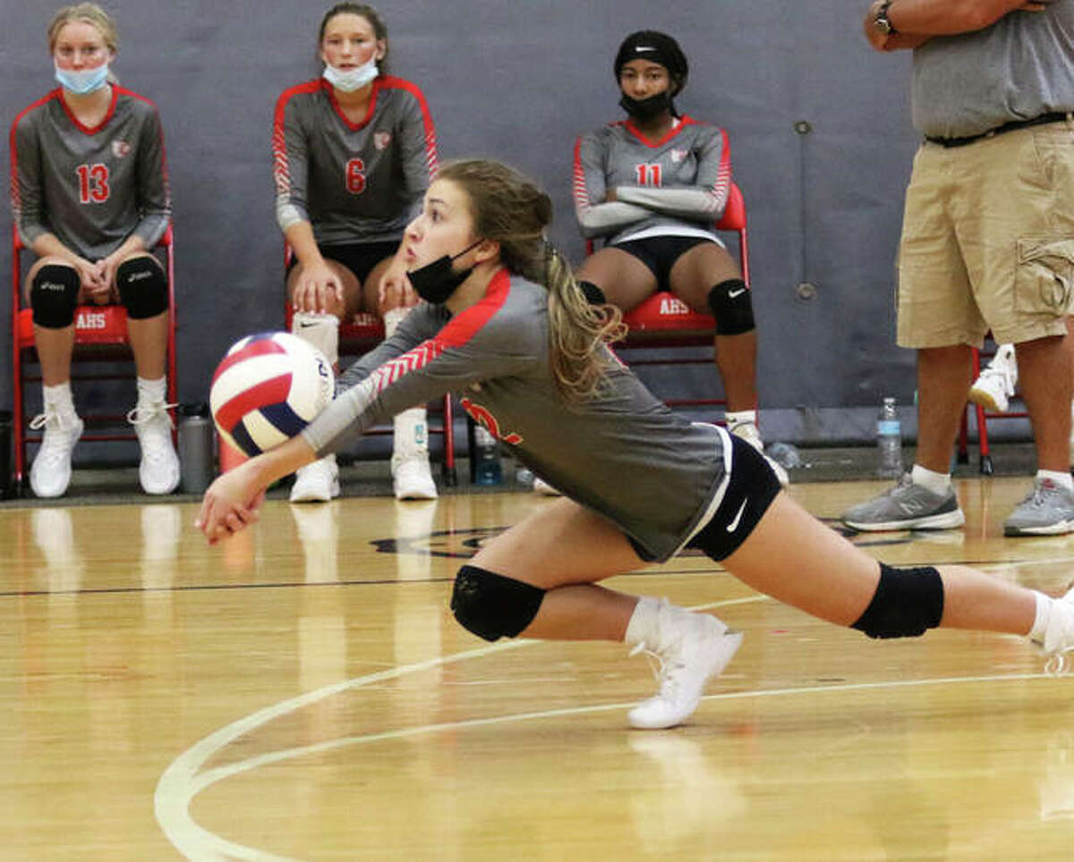 Alton defensive specialist Payton Olney dives to make a dig Saturday against Granite City in a third-place match at the Alton Tourney in Godfrey.