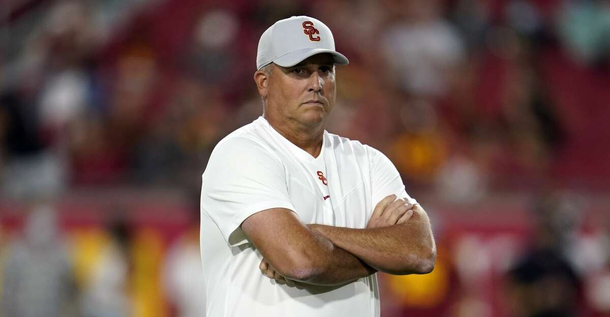 Southern California head coach Clay Helton watches warm ups on the field before an NCAA college football game against Stanford Saturday, Sept. 11, 2021, in Los Angeles. (AP Photo/Marcio Jose Sanchez)