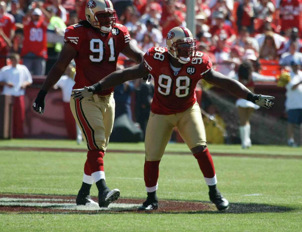 San Francisco 49ers Ray McDonald (91) and Parys Haralson (98) celebrate their defensive play. The San Francisco 49ers host the Arizona Cardinals in their NFL season opener at Candlestick Park in San Francisco, Calif., on Sept. 7, 2008. Arizona won 23-13.