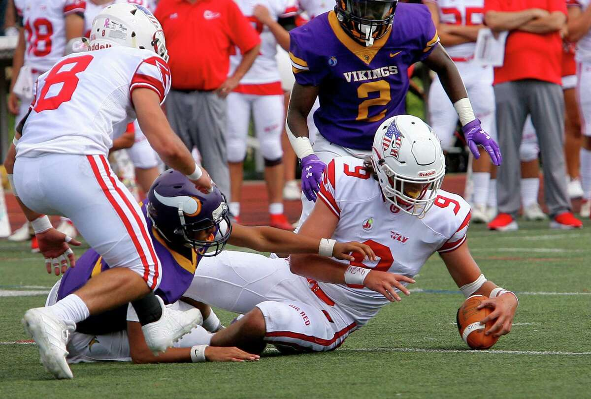 Greenwich's Dominic Deluca (9) recovers a fumble by Westhill's Anwar Tahir (12) on Saturday.