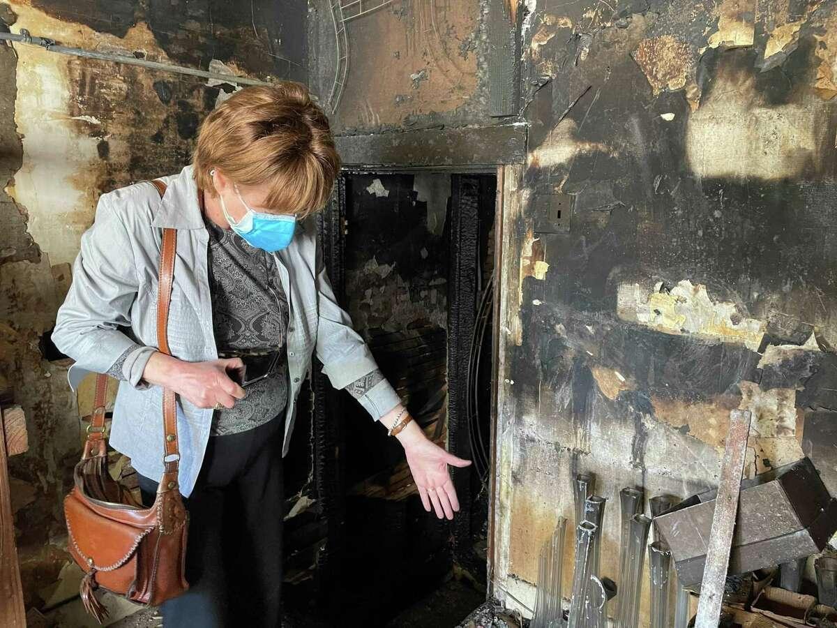 Frank's Floral Shop owner Sona Pehlivanian stands in her burned-out shop in San Francisco's Sunset District on Sunday.