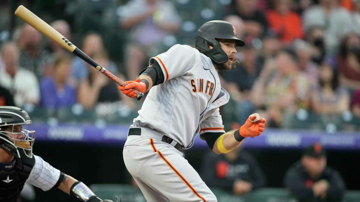 San Francisco Giants shortstop Brandon Crawford (35) in the first inning of a baseball game Tuesday, Sept. 7, 2021, in Denver. (AP Photo/David Zalubowski)