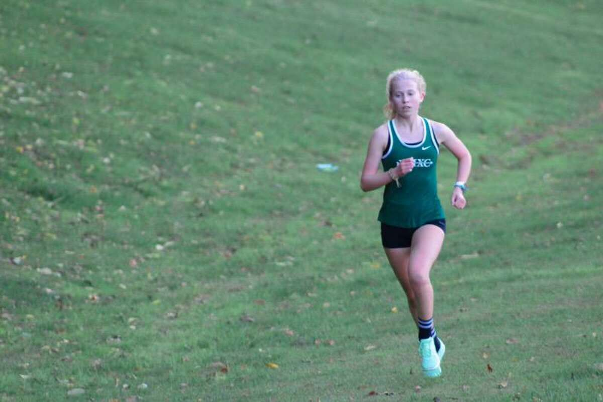 New Milford senior Maddie Sweeney returns as one of the state's top high school girls cross country runners ahead of the 2021 season. Sweeney had a successful junior season after bettering her sophomore times by over four minutes.
