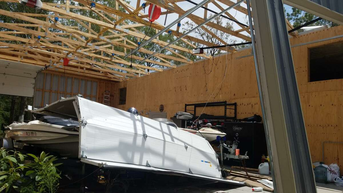 Hurricane Laura ripped off the metal roof of this home and attached garage on Gypsy Lane in Orange. Photo taken Aug. 28, 2020, by Fran Ruchalski / Beaumont Enterprise