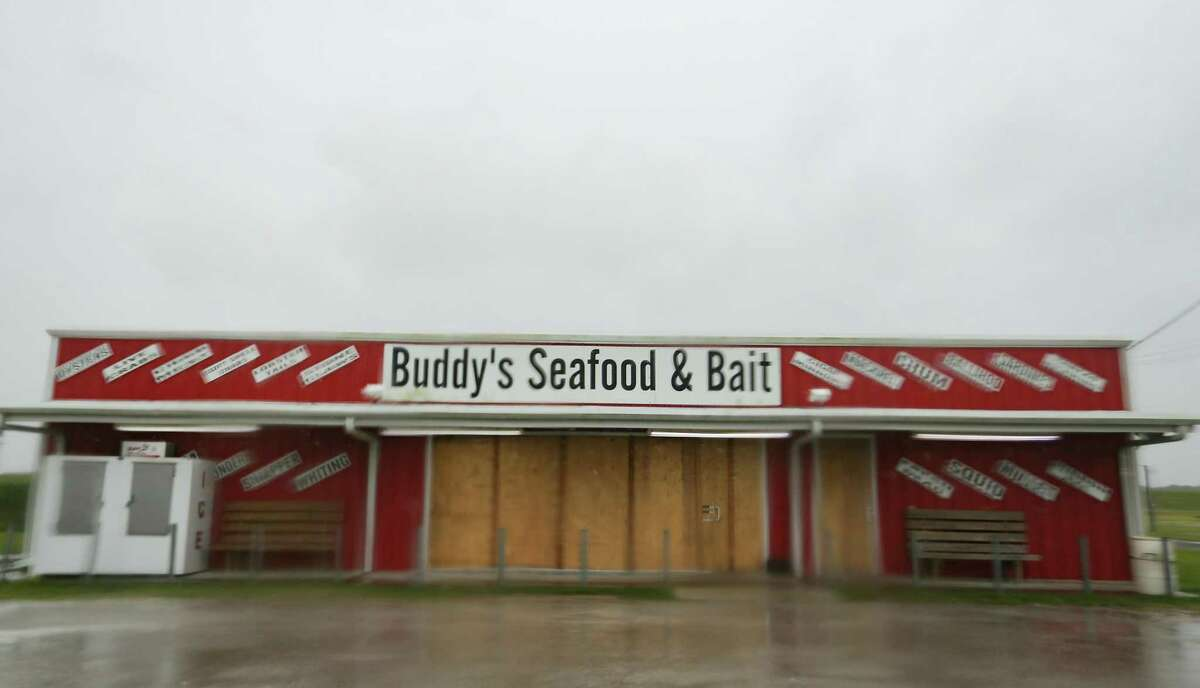 Plywood covers the windows and doors of Buddy's Seafood & Bait as as Tropical Storm Nicholas approaches in Matagorda on Monday, Sept. 13, 2021.