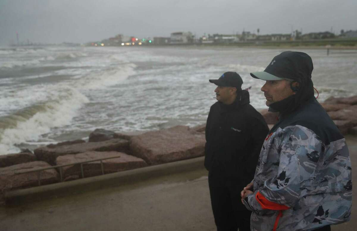 Jaime Ybarra, right, and his friend Frank Rivera watch their lines as they fish as Tropical Storm Nicholas moves towards the Texas coast Monday, Sept. 13, 2021, along the seawall in Galveston.