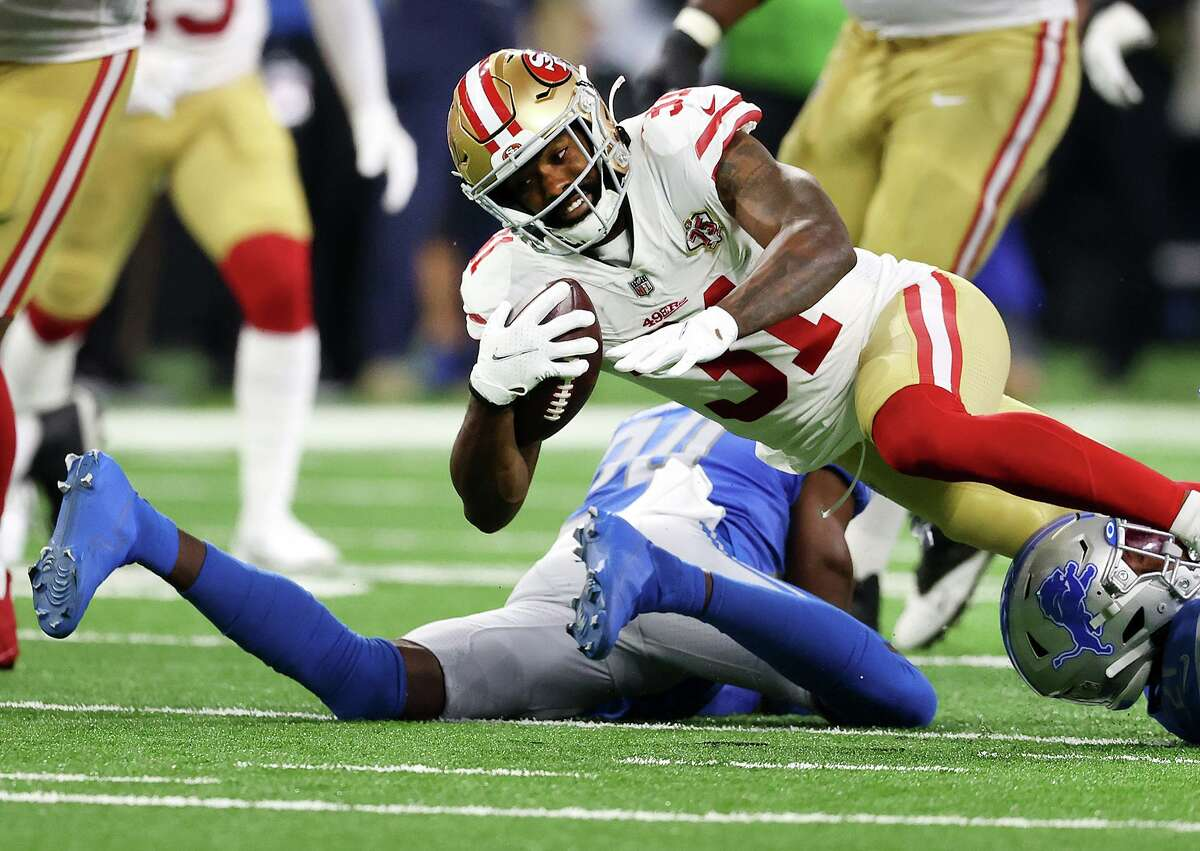 Raheem Mostert (31) of the San Francisco 49ers is tackled during the first half against the Detroit Lions at Ford Field on September 12, 2021 in Detroit.
