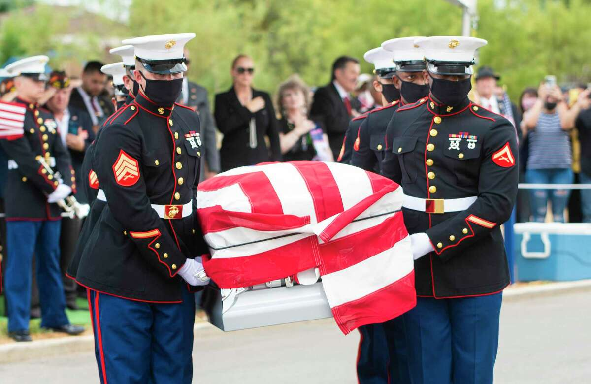 United States Marines move Lance Cpl. David Lee Espinoza's coffin at the City of Laredo Cemetery on Monday, Sept. 13, 2021.