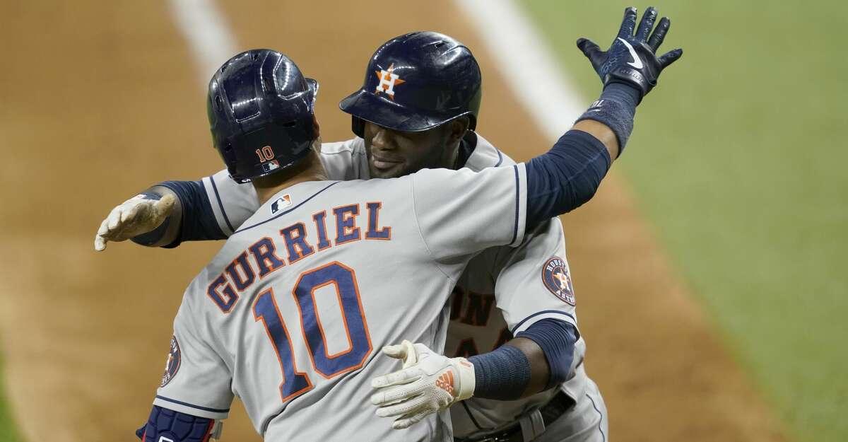Houston Astros' Yuli Gurriel (10) and Yordan Alvarez, right, celebrate a solo home run hit by Alvarez in the seventh inning of a baseball game against the Texas Rangers in Arlington, Texas, Monday, Sept. 13, 2021. (AP Photo/Tony Gutierrez)