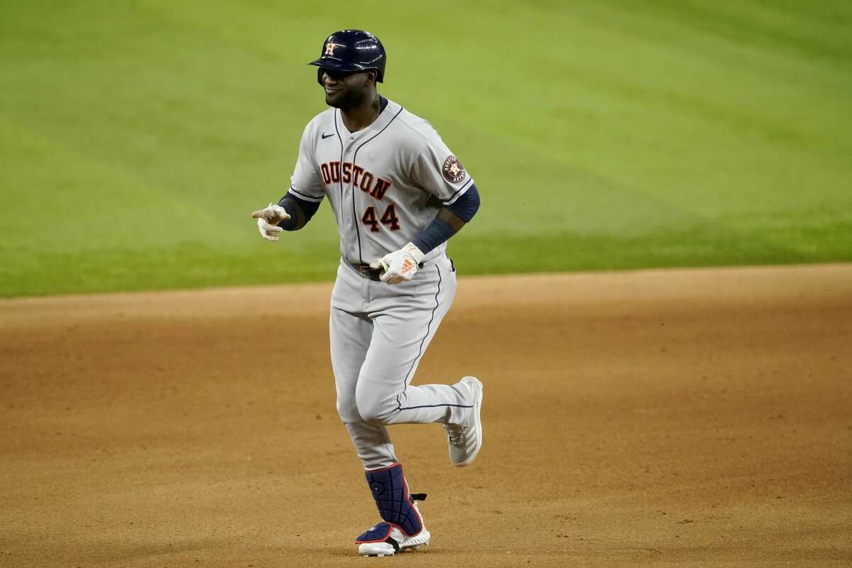 Houston Astros' Yordan Alvarez points to the team's dugout as he rounds the bases following his solo home run in the seventh inning of a baseball game against the Texas Rangers in Arlington, Texas, Monday, Sept. 13, 2021. (AP Photo/Tony Gutierrez)
