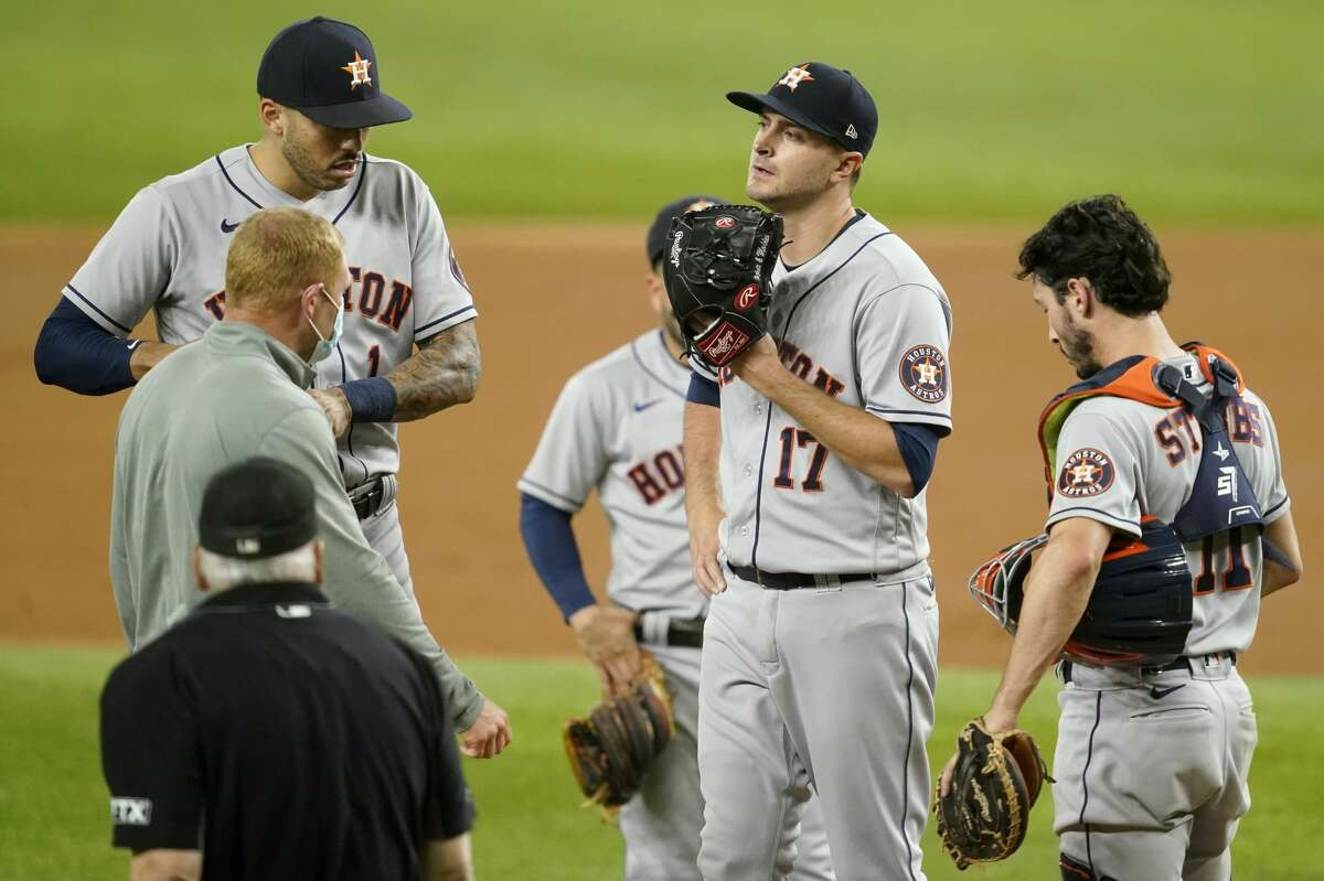 Jake Odorizzi (17) was lifted during the second inning Monday because of a foot injury suffered while making a play defensively against the Rangers.