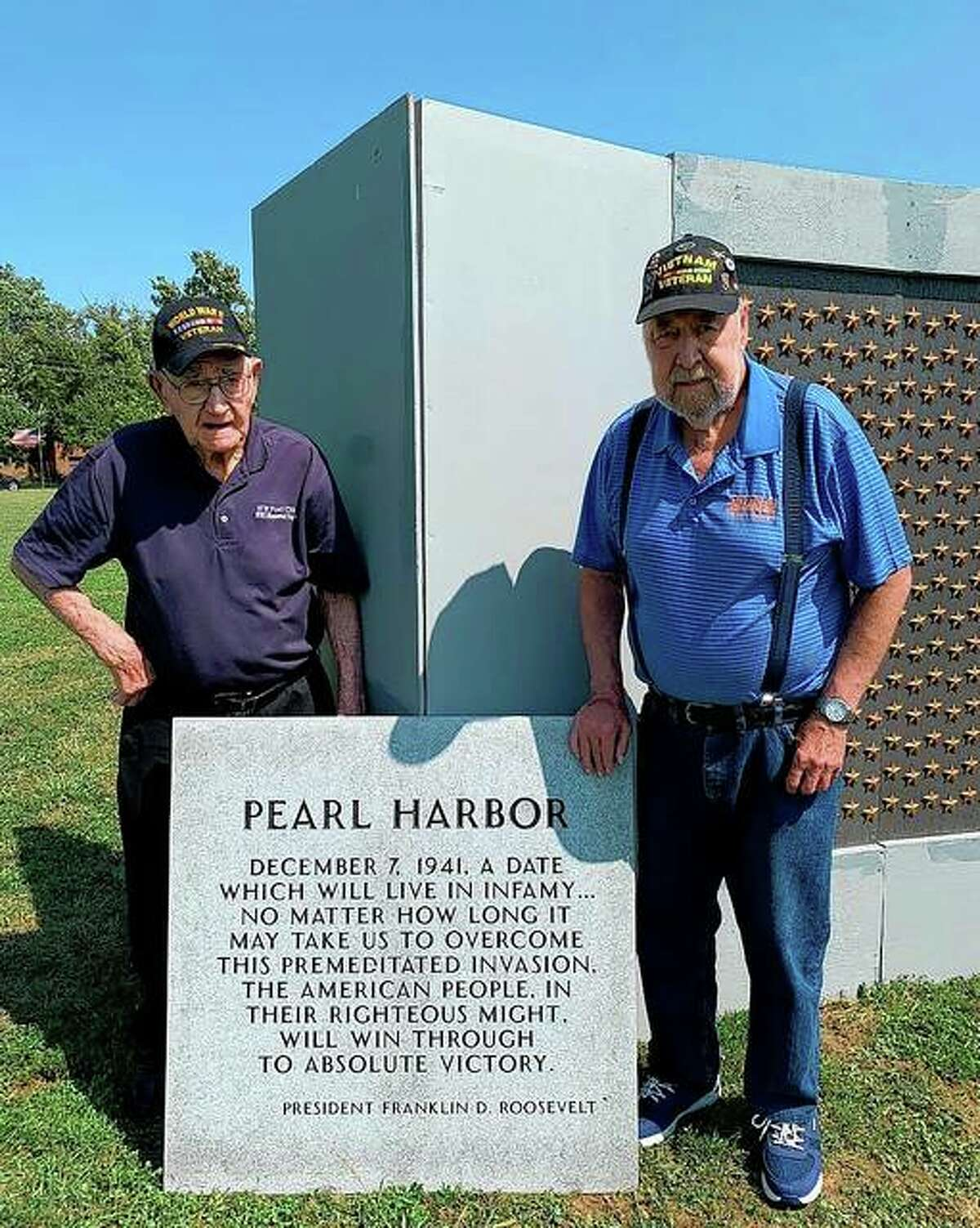 World War II veteran Charles Weishaar (left), 101, and his son, Steve Weishaar, who served in Vietnam as a combat medic, visit the traveling World War II memorial this past weekend at Prairie Land Heritage Museum.