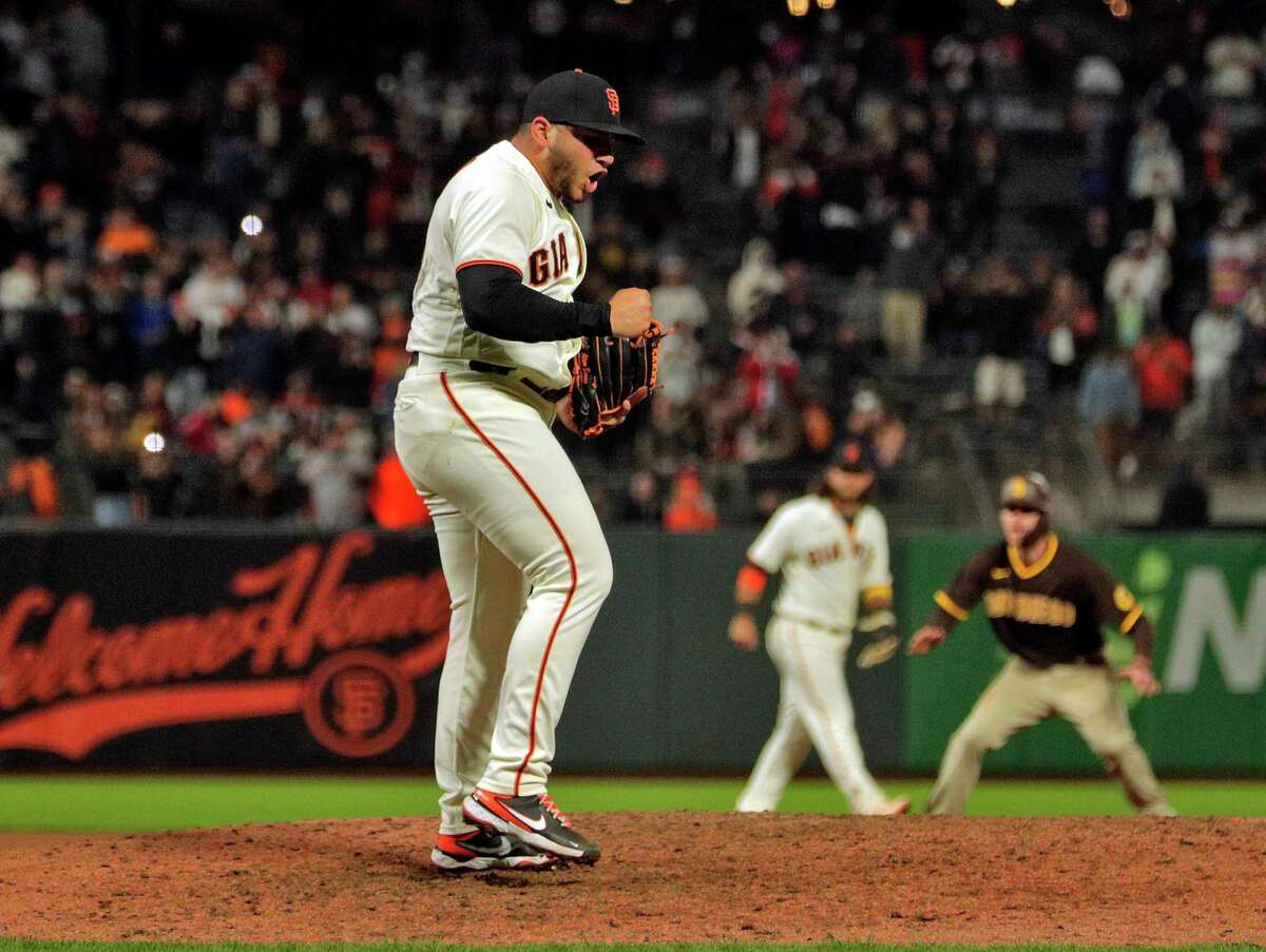 Kervin Castro strikes out the last batter as the San Francisco Giants defeat the San Diego Padres 9-1 and clinch a playoff berth on Monday.