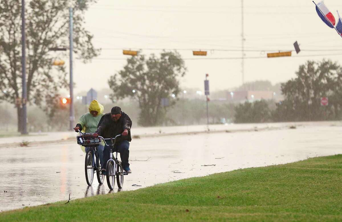 Cyclists make their way down a street in Bay City, Texas as Tropical Storm Nicholas approaches on Monday, Sept. 13, 2021. Nicholas made landfall about 25 miles inland of Bay City.