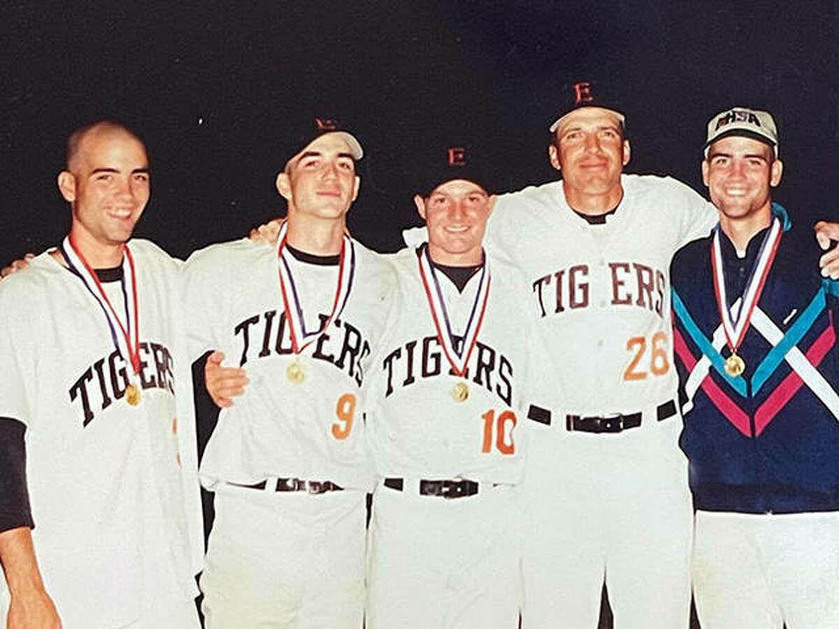 Justin Hampson, second from left, with Edwardsville pitchers Ben Hutton, left, Brad Grotefendt, middle, EHS pitching coach Mike Waldo, second from right, and pitcher James Hutton, after the Tigers won the Class AA state championship in 1998.