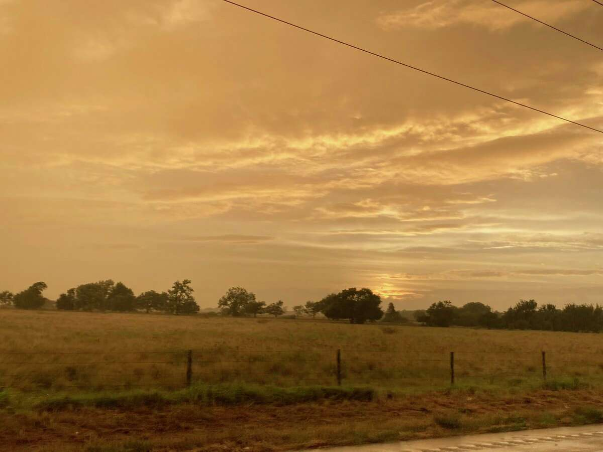 Many people noticed an orange sky as the sun set on Monday, Sept. 13, 2021, ahead of Tropical Storm Nicholas.