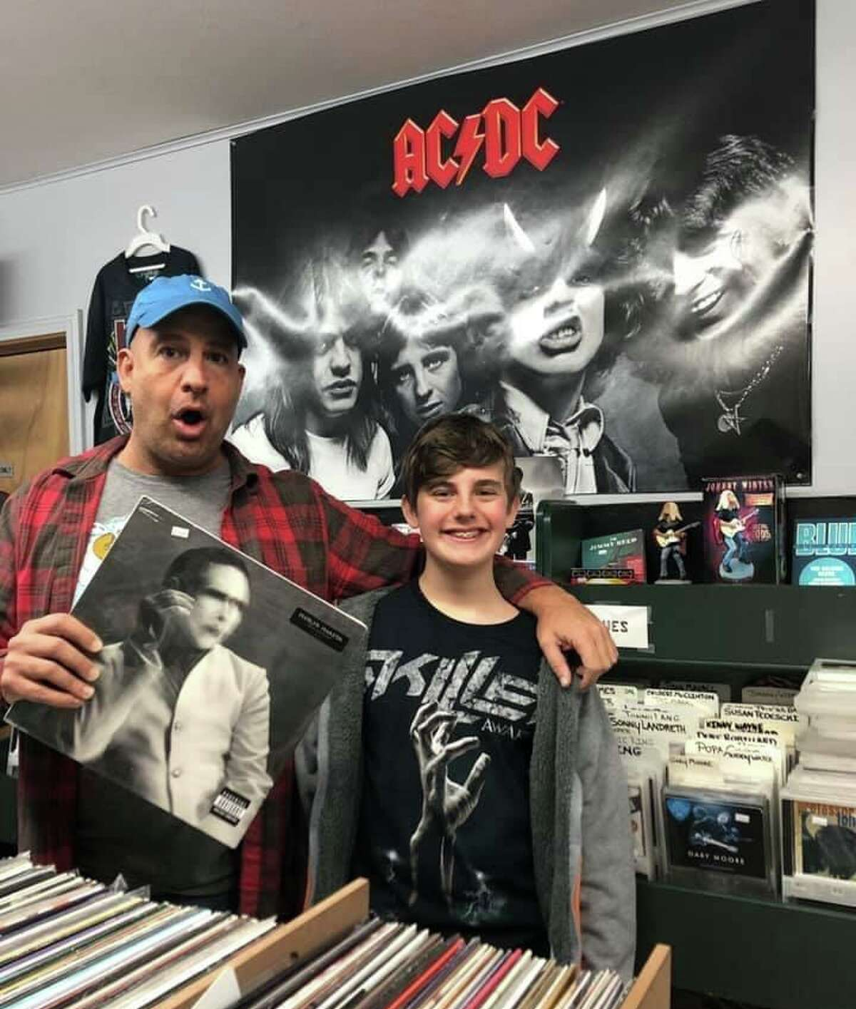 Vinnie Penn and son riding the vinyl wave at Exile on Main Street in Branford. Vinyl has been back for a while, but for this writer, it never went away.
