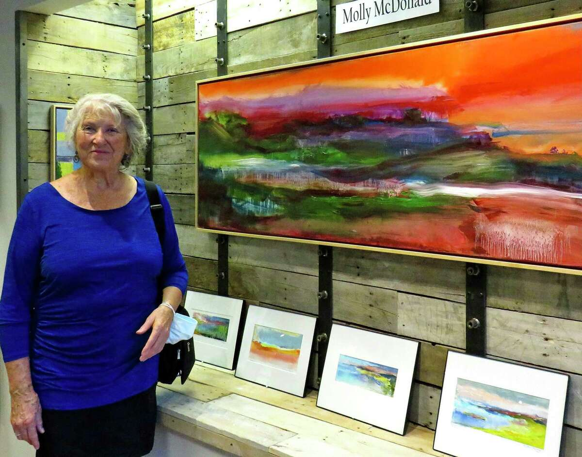 Above, Painter Molly Sullivan McDonald at opening for BACA fall gallery exhibit on Branford's Main Street. At right,