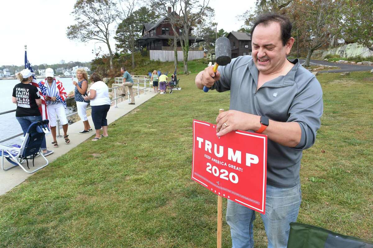 Dominic Rapini of Branford planted a Trump sign at the Boaters for Trump and Blue Lives Matters Boat Parade at Branford Point in September, 2020. He is currently campaigning for the Republican nomination to run for secretary of the state in 2022.
