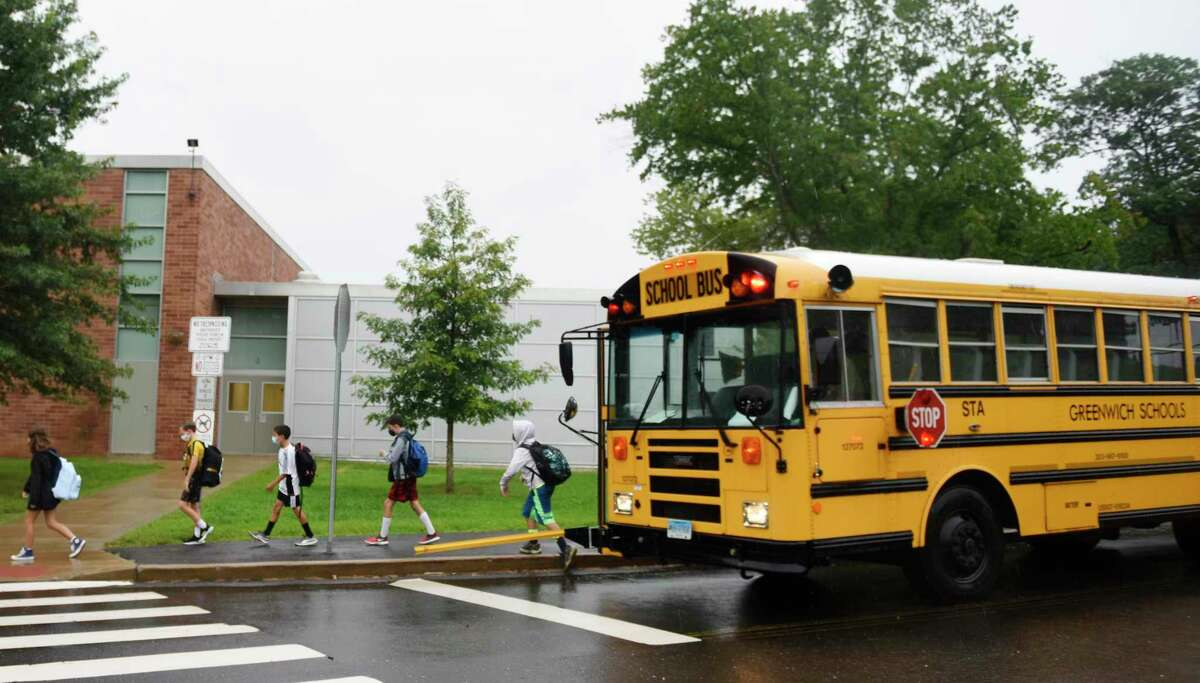 Students enter school on the first day of the 2021-2022 school year at Western Middle School in Greenwich, Conn. Wednesday, Sept. 1, 2021.