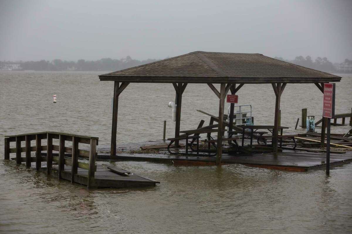The Clear Lake Park Fishing Pier is submerged under high water and damaged Tuesday, Sept. 14, 2021, in Seabrook.