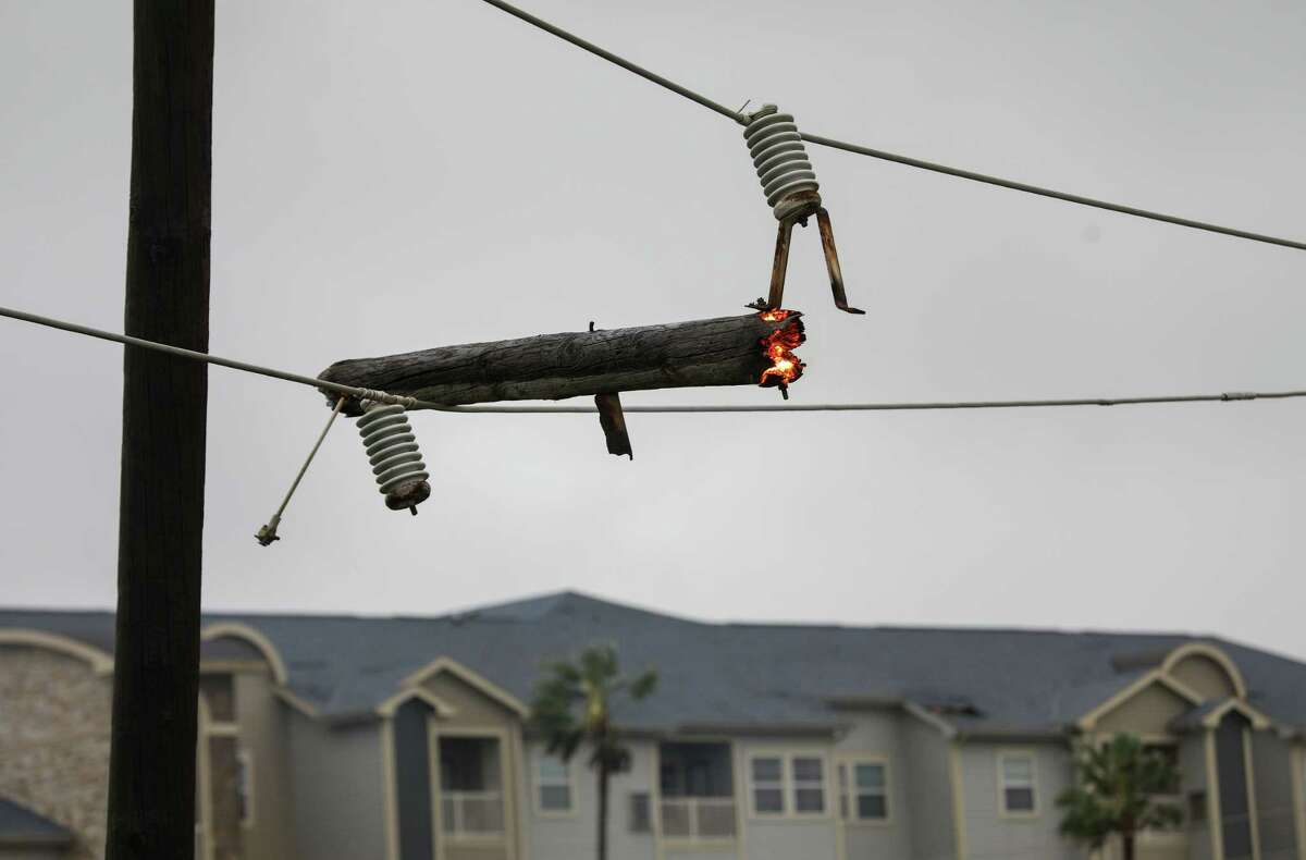 A live electrical wire burns part of a broken utility pole Tuesday, Sept. 14, 2021, in Galveston. Earlier that morning, Hurricane Nicholas made landfall south along the coast.