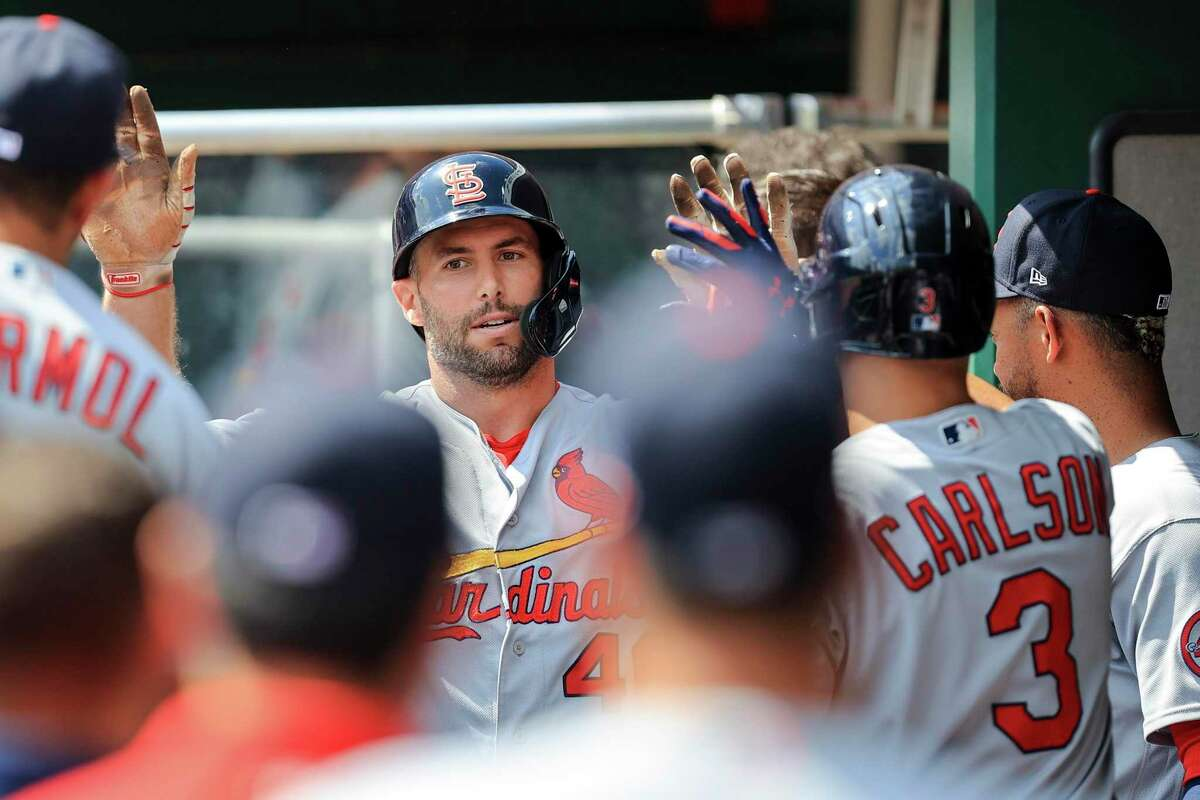 St. Louis Cardinals' Paul Goldschmidt celebrates with teammates after hitting a two-run home run during the fourth inning of the first game of a doubleheader baseball game against the Cincinnati Reds in Cincinnati, Wednesday, Sept. 1, 2021. (AP Photo/Aaron Doster)
