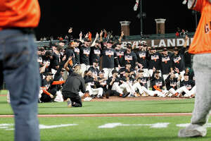 The Giants gather on the pitching mound for a victory picture after the game between the San Diego Padres and San Francisco Giants