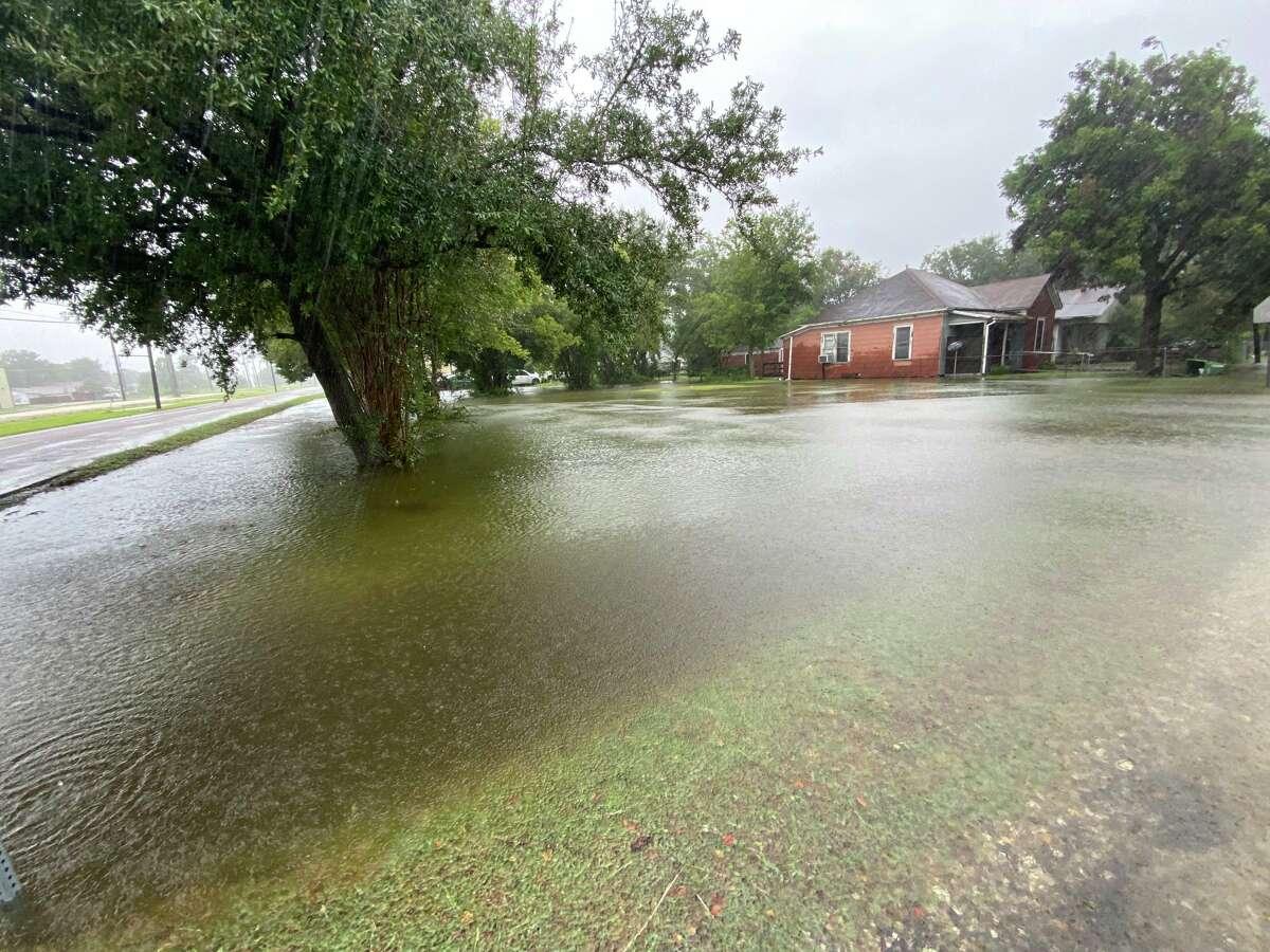 A yard has flooded along Ninth Avenue in Port Arthur.