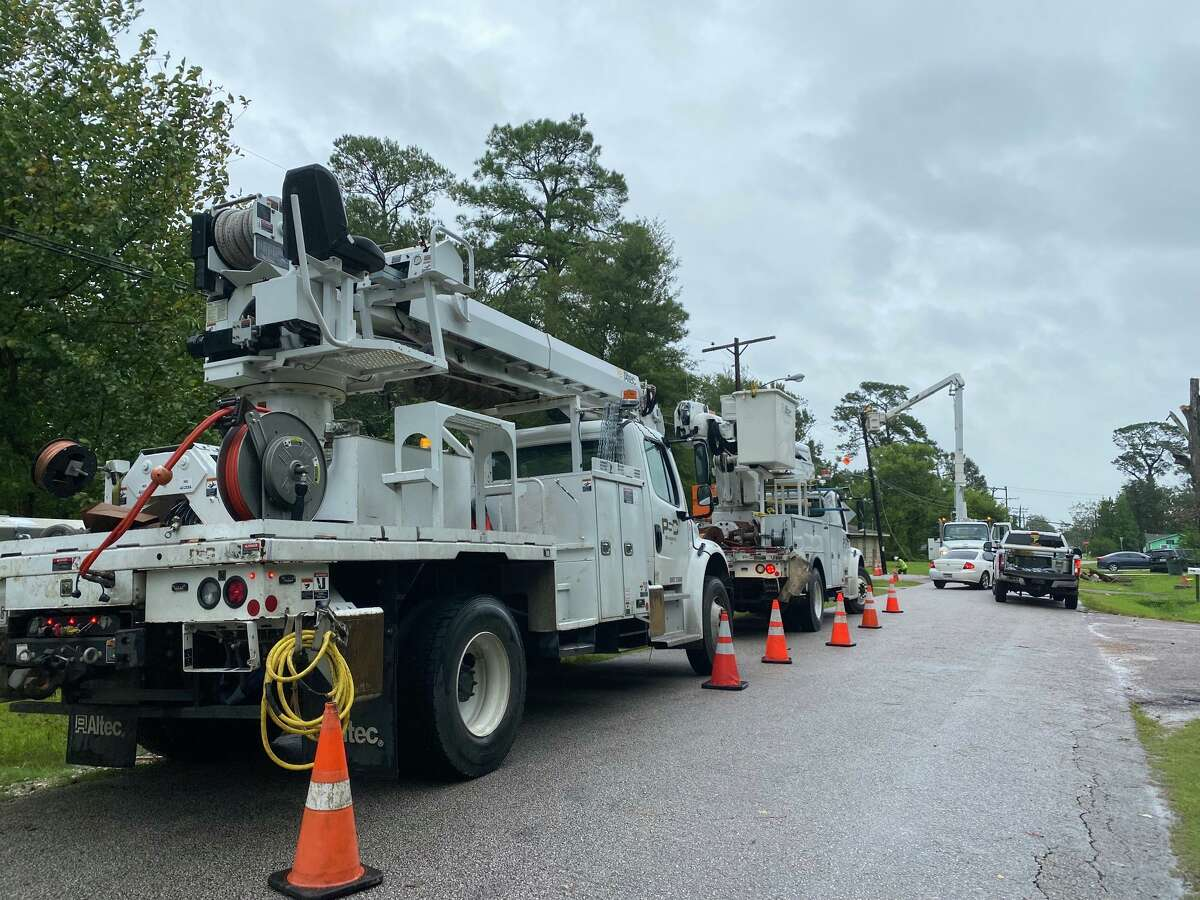 Crews work on repairing a utility pole on Harding Drive in Beaumont's north end.
