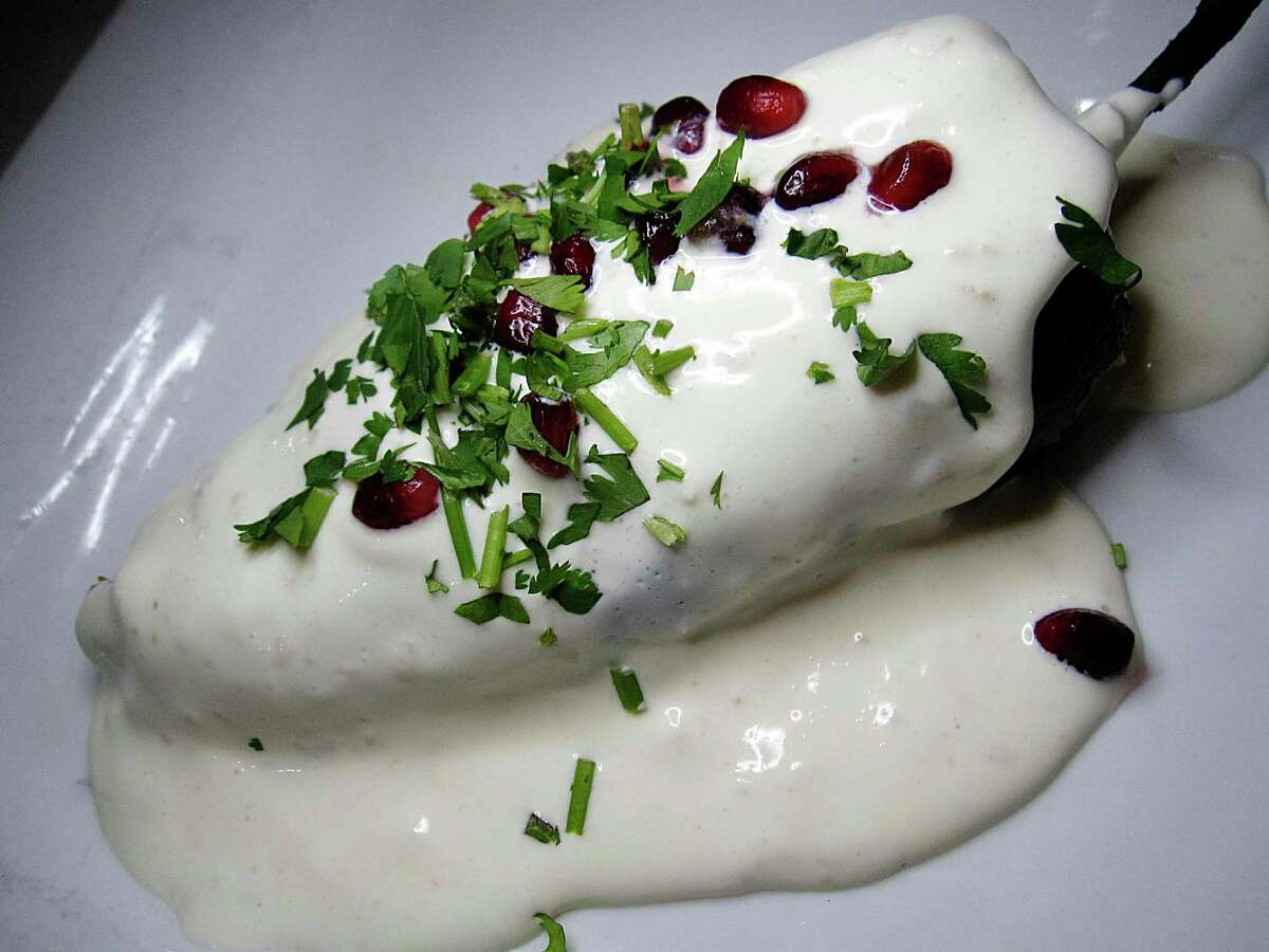 The chile en nogada at SoLuna Mexican restaurant incorporates beef, pork, almonds, pomegranates and dried fruit in a poblano pepper with almond cream.