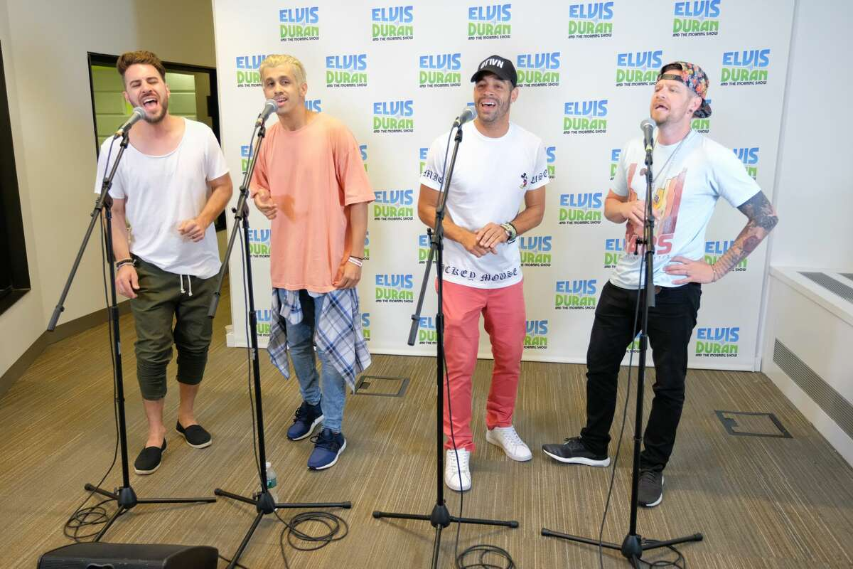 """NEW YORK, NY - JULY 24: (L-R) Dan Miller, Erik-Michael Estrada, Trevor Penick and Jacob Underwood of the band O-Town perform live on """"The Elvis Duran Z100 Morning Show"""" at Z100 Studio on July 24, 2017 in New York City. (Photo by Matthew Eisman/Getty Images)"""