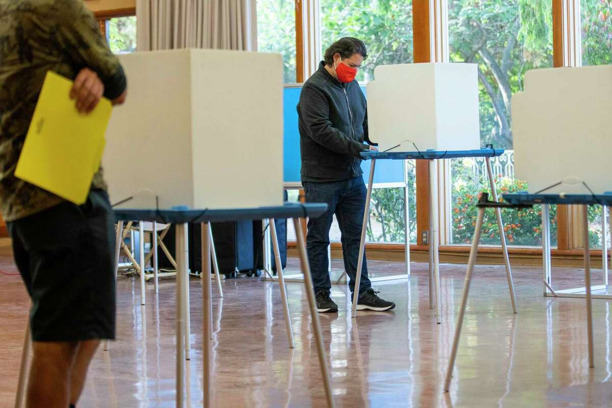 Thomas Pastrano votes in the California gubernatorial recall election at the polling place located inside the Lakeside Park Garden Center in Oakland, Calif.