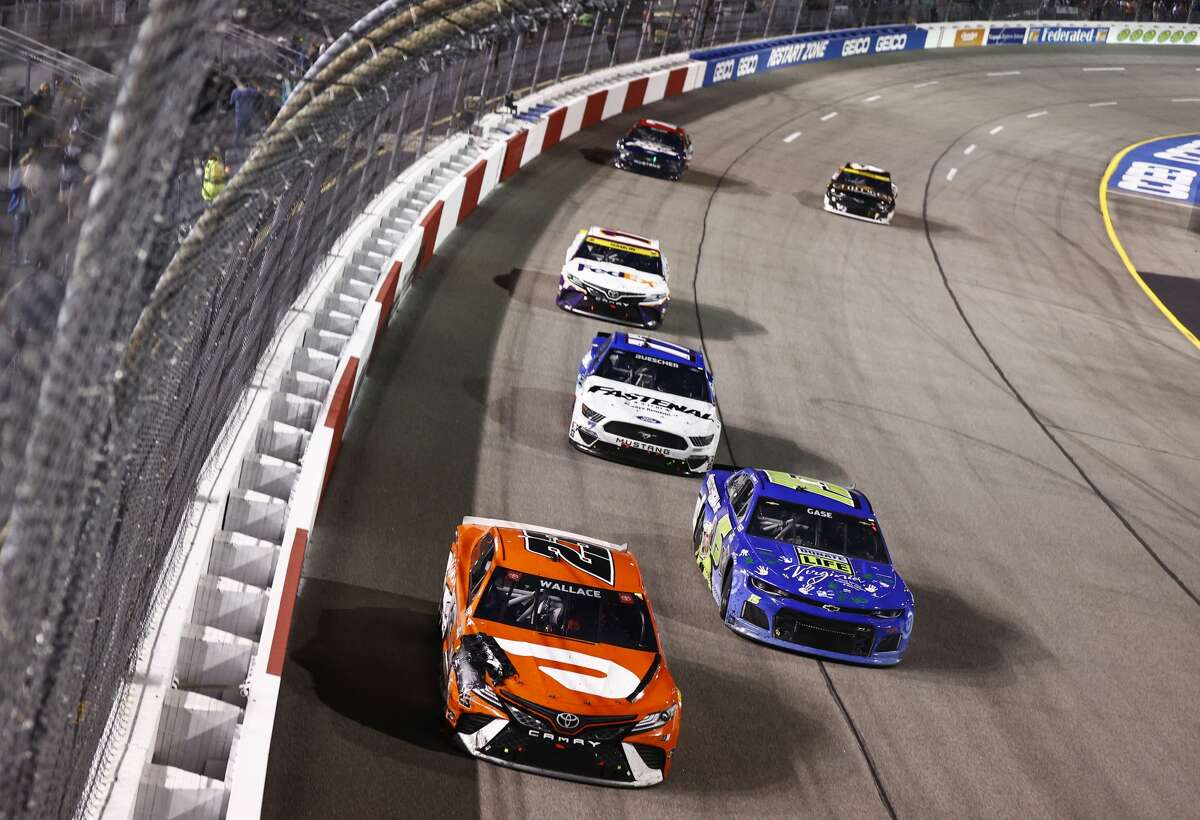Bubba Wallace, driver of the #23 Door Dash Toyota, leads a pack of cars during the NASCAR Cup Series Federated Auto Parts 400 Salute to First Responders at Richmond Raceway on September 11, 2021 in Richmond, Virginia. (Photo by Jared C. Tilton/Getty Images)