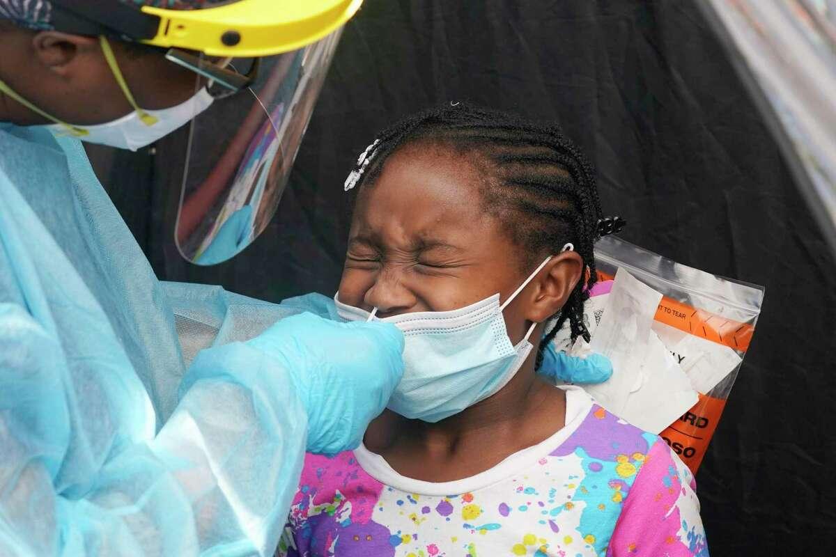 Dorah Cerisene, 9, gets tested for COVID-19, Tuesday, Aug. 31, 2021.