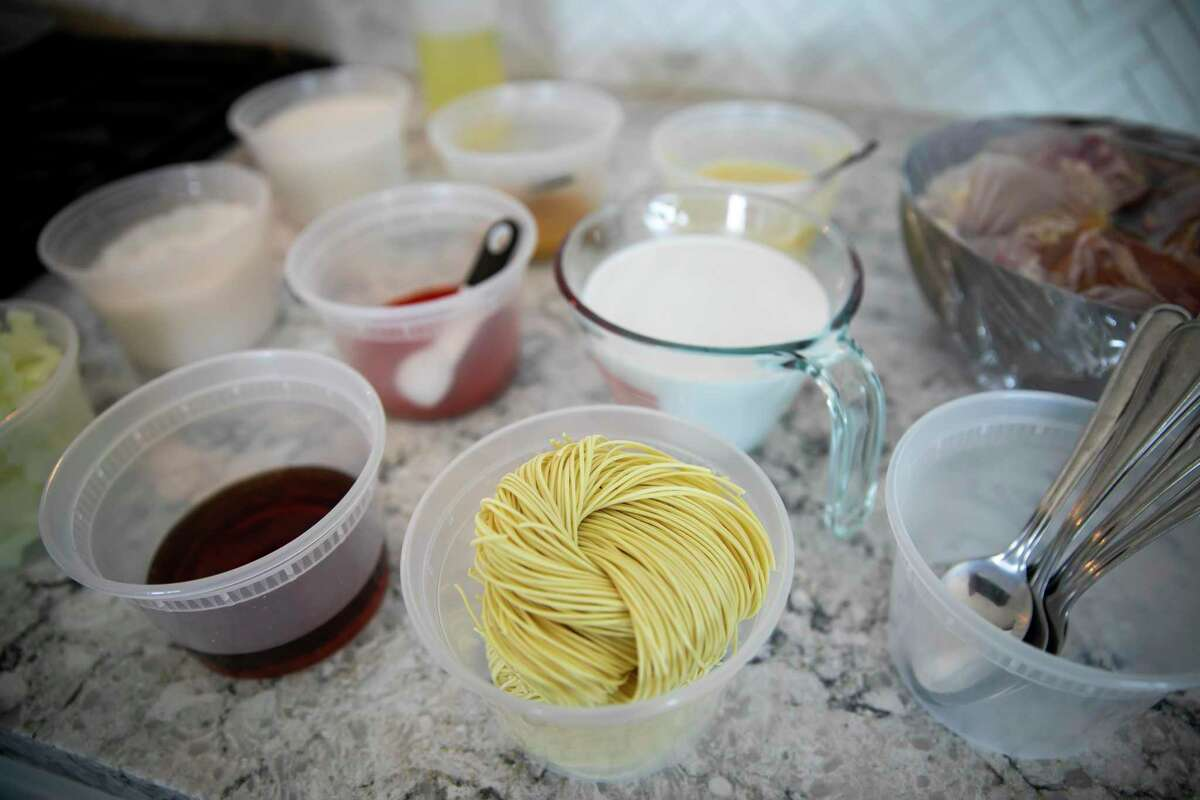 Ingredients are carefully laid out in the kitchen of Houstonian Suu Khin, a food blogger who specializes in Burmese cuisine, in her apartment on Friday, Sept. 10, 2021. Khin is a finalist on MasterChef and hopes her exposure brings awareness of Burmese cuisine to the world.