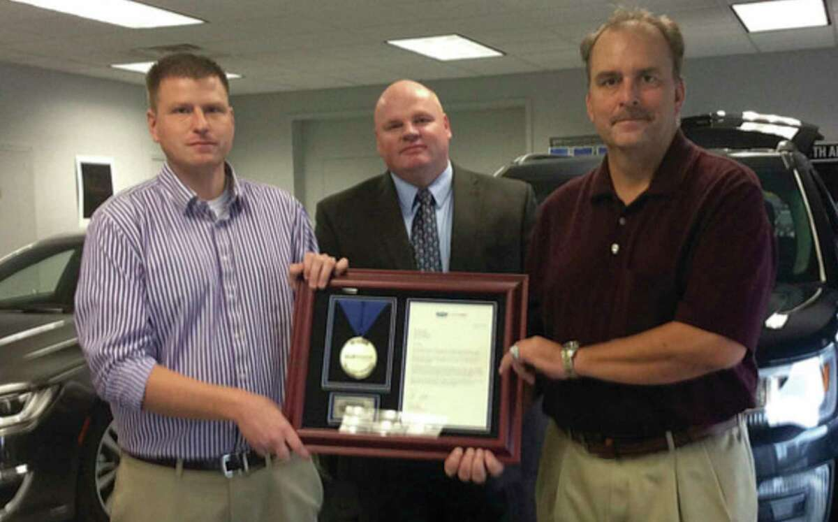 Ordus Ford owner Greg Ordus, right, passed away unexpectedly on Sept. 4. Above, Greg is shown in a 2016 photo with his brother, Joe, left, as the dealership is recognized for its 40th anniversary by Ford Credit's Steve Egelhoff. (Tribune File Photo)