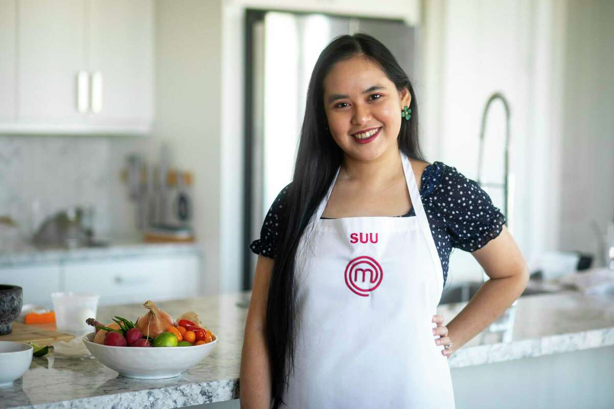 Houstonian Suu Khin, a food blogger who specializes in Burmese cuisine and Masterchef finalist, prepares a traditional Burmese dish in her apartment on Friday, Sept. 10, 2021. Khin hopes her exposure on Masterchef brings awareness of Burmese cuisine to the world.