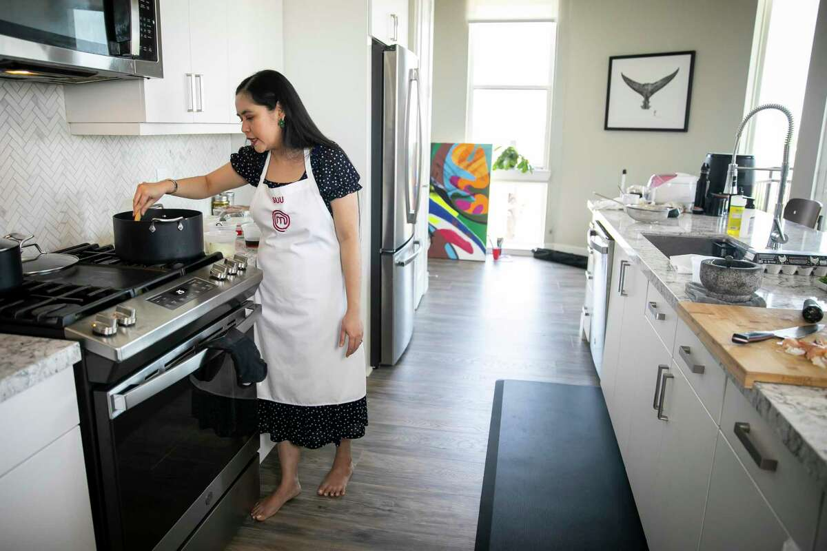 Houstonian Suu Khin, a food blogger who specializes in Burmese cuisine and MasterChef finalist, prepares a traditional Burmese dish in her apartment on Friday, Sept. 10, 2021.