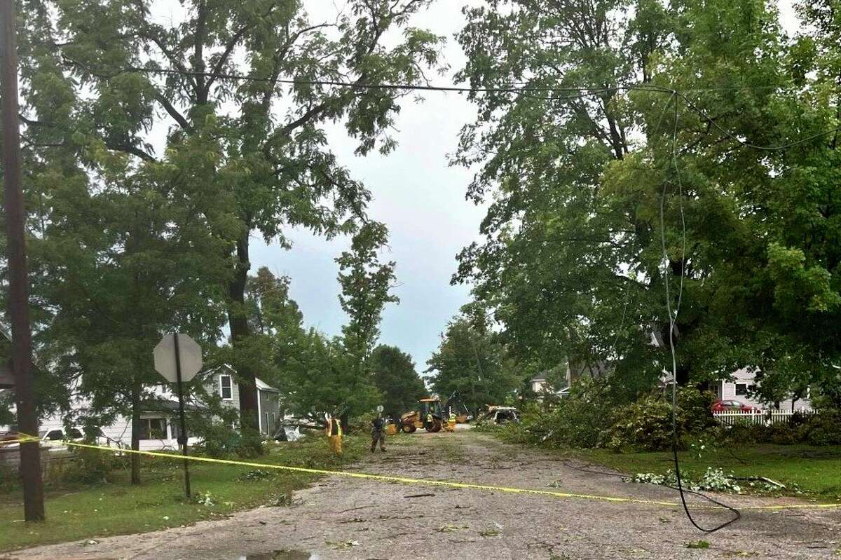 Downed power lines hang in the street in Evart as crews work to clean up after the recent storm. (Photo courtesy of Casi Porter)