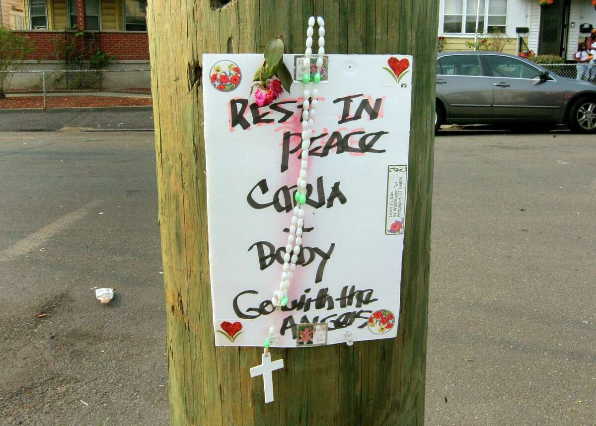 A memorial for 22-year-old Karla Bermudez was setup in front of a home on the corner of Washington Terrece and Washington Place in Bridgeport, Conn., on Tuesday Sept. 15, 2020.