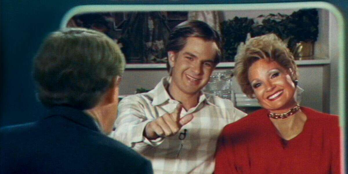 """Andrew Garfield, center, and Jessica Chastain, right, are once-married televangelists Jim and Tammy Faye Baker in """"The Eyes of Tammy Faye,"""" shown here subbed into a real 1987 interview with Ted Koppel on ABC's """"Nightline."""""""