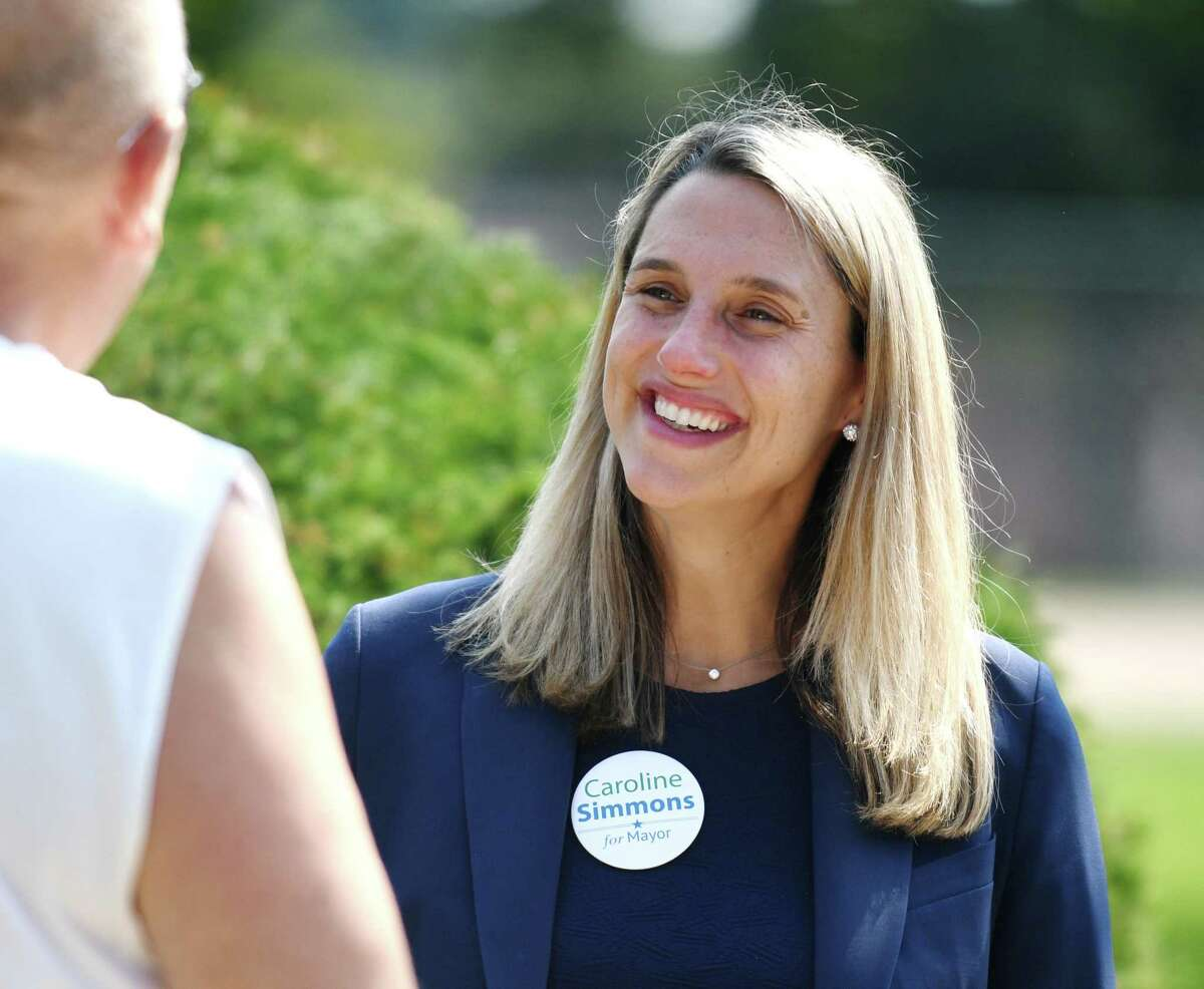 Mayoral candidate state Rep. Caroline Simmons chats with a voter outside Dolan Middle School on Primary Election Day in Stamford on Tuesday.