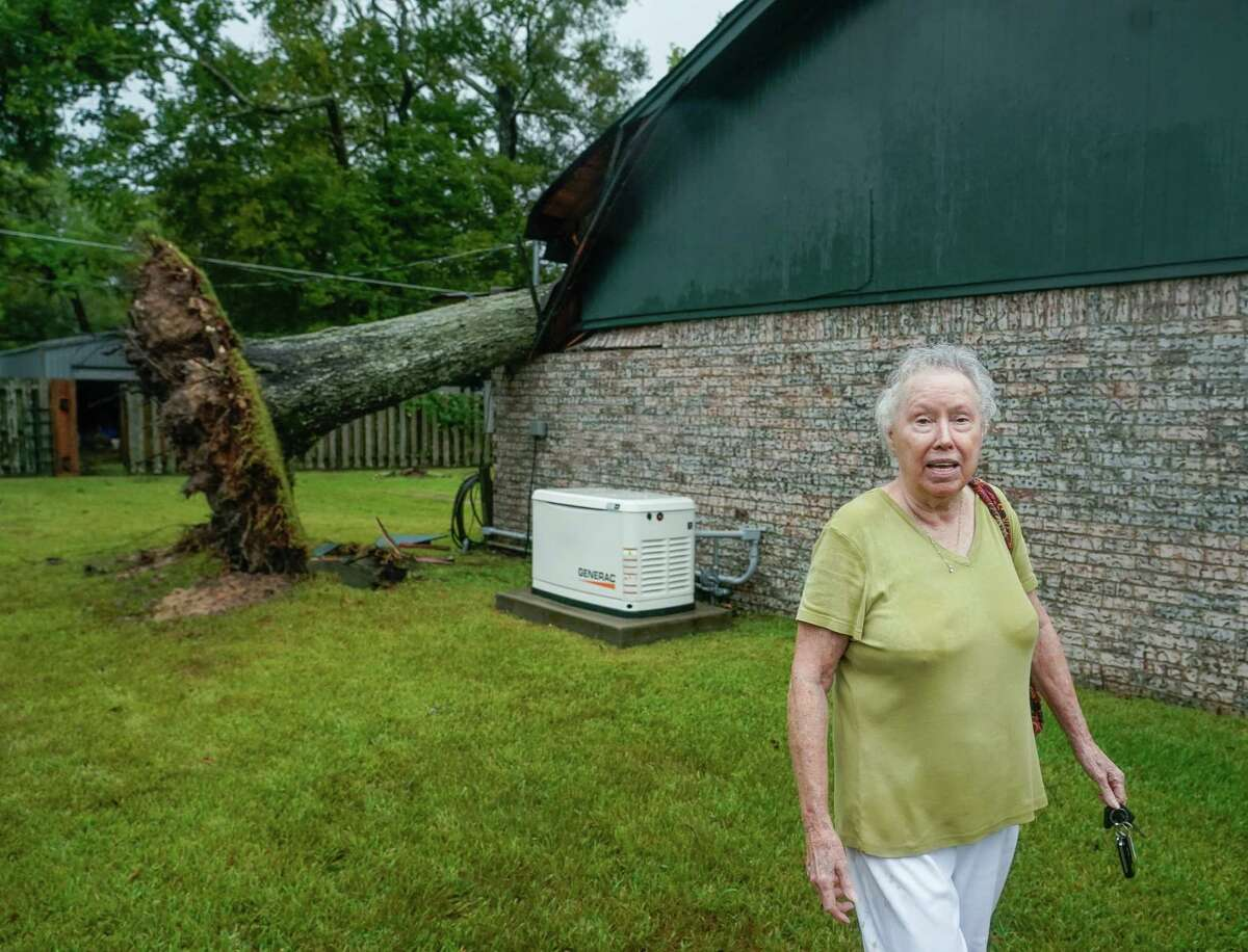 Marie Davis looks at the damage caused by a tree which was knocked over into her home during Tropical Storm Nicholas, on Tuesday, Sept. 14, 2021, in Baytown. This is the third time a tree has fallen into Davis' home; hurricanes Alicia and Ike were the prior two occurrences.