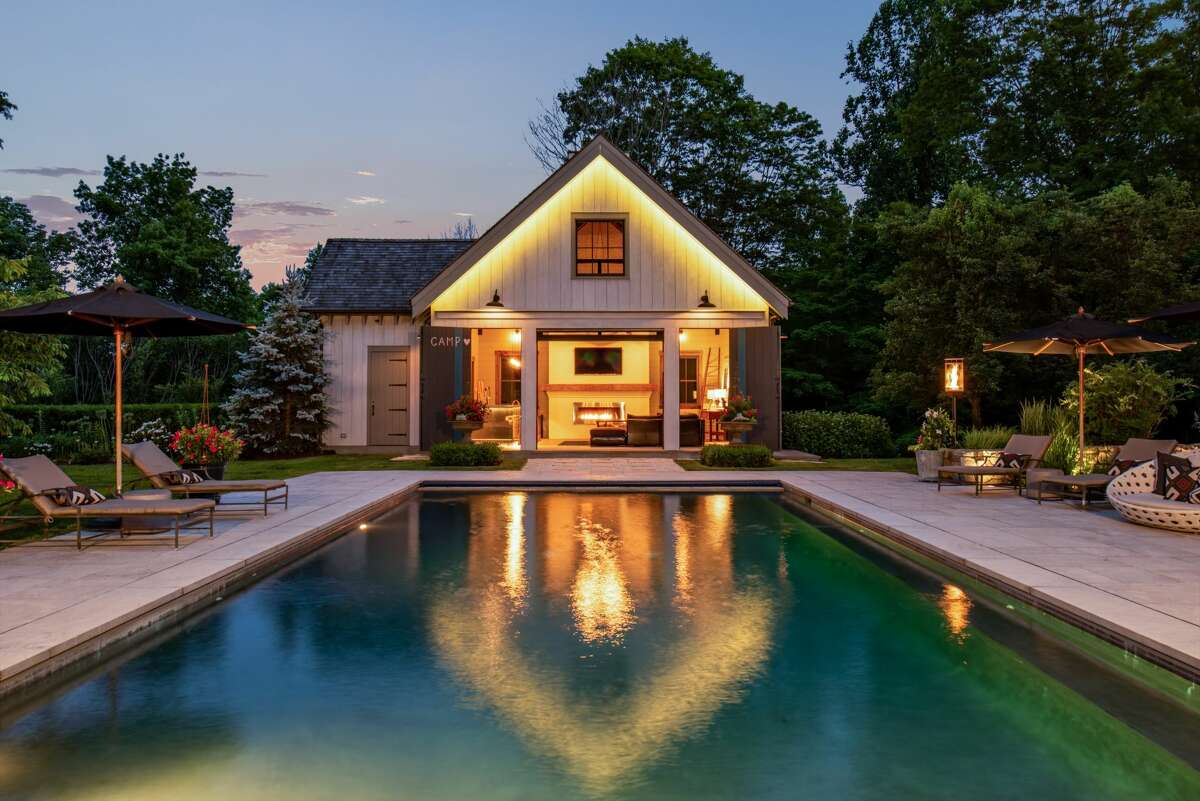 The home on 33 Chestnut Woods Road in Redding, Conn. has a heated Gunite pool and a pool house barn in its backyard.