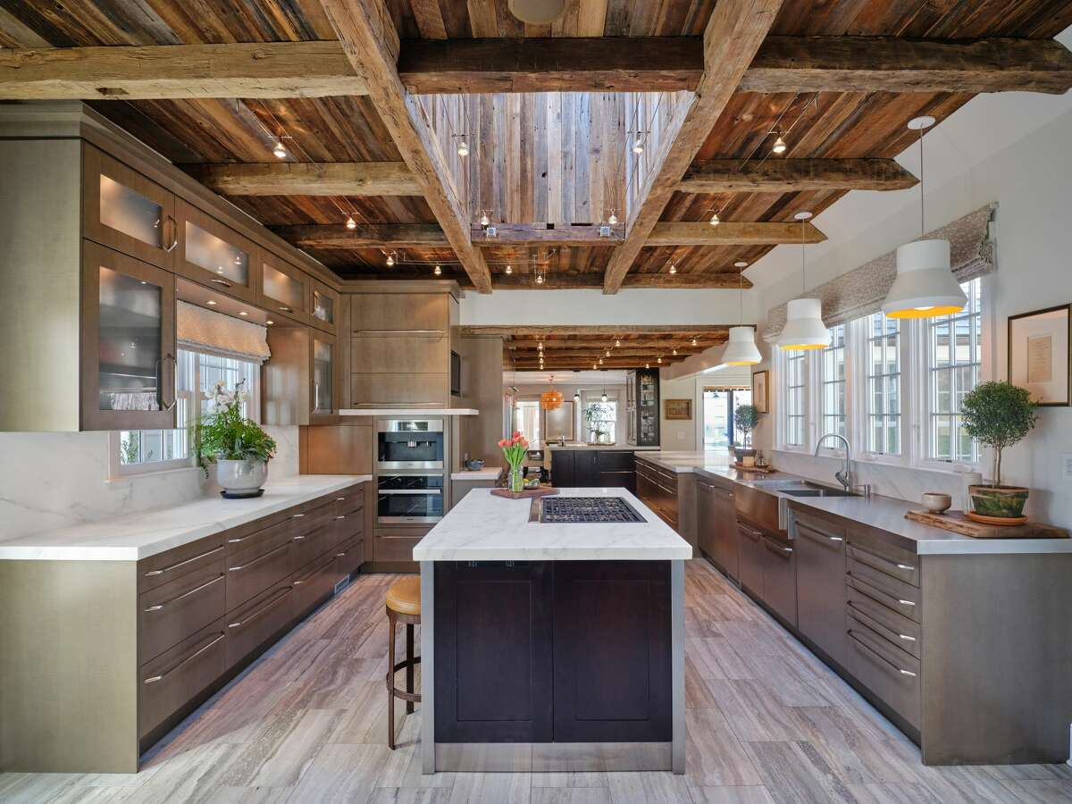 The kitchen home on 33 Chestnut Woods Road in Redding, Conn. has barn wood beams on the ceiling.